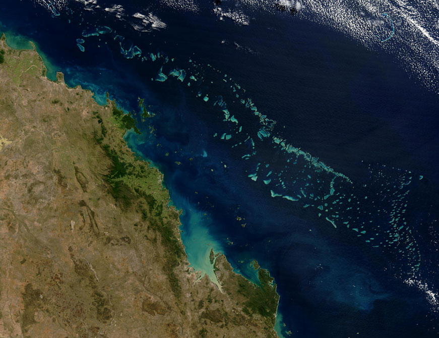 Satellite image of part of the Great Barrier Reef adjacent to the Queensland coastal areas of Airlie Beach and Mackay.